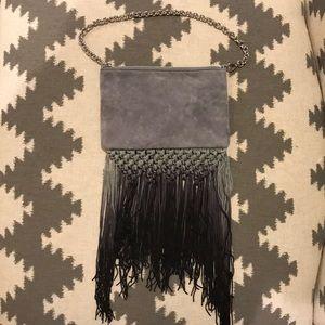 """""""Henri Bendel"""" grey suede & crochet fringe purse."""